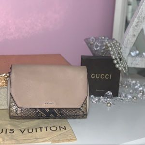 Coach pink and snakeskin clutch